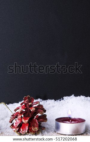 Blackboard with snow and christmas candles