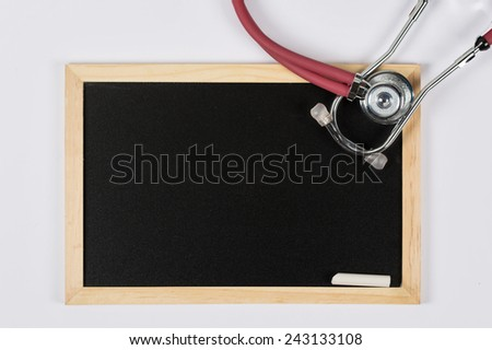 Blackboard with Stethoscope - stock photo