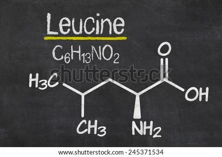 Blackboard with the chemical formula of Leucine - stock photo
