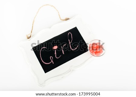 """Blackboard with the inscription """"girl"""" around pink chewy candy jelly beans - stock photo"""