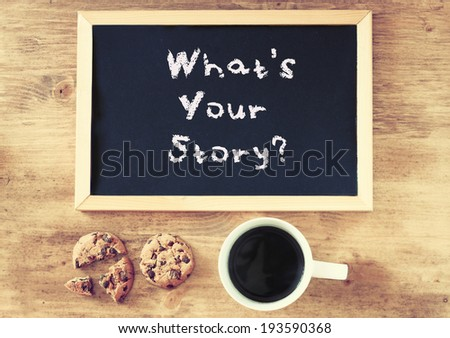 blackboard with the phrase whats your storry and cup of coffee and cookies - stock photo