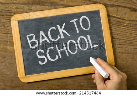 Blackboard with the text Back to school - stock photo