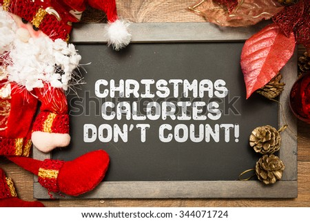 Blackboard with the text: Christmas Calories Don't Count - stock photo