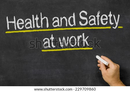 Blackboard with the text Health and Safety at work - stock photo