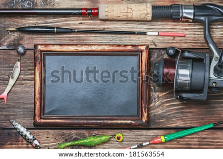 blackboard with the word fishing, and other accessories - stock photo