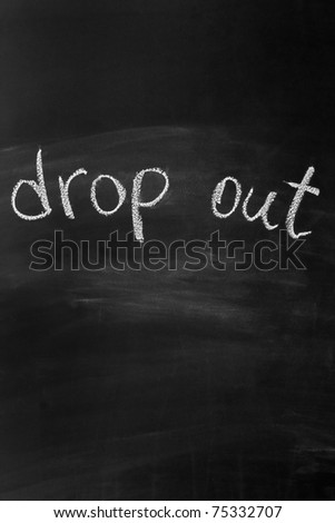 "Blackboard with the words ""drop out"" written in white chalk"