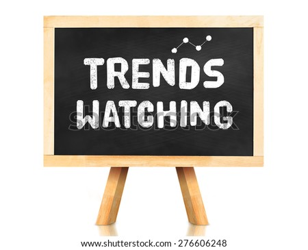 Blackboard with Trend watching word and icon on white background ,Business concept. - stock photo