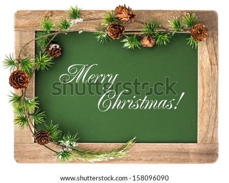blackboard with wooden frame and christmas decoration isolated on white background. antique chalkboard with sample text Merry Christmas - stock photo