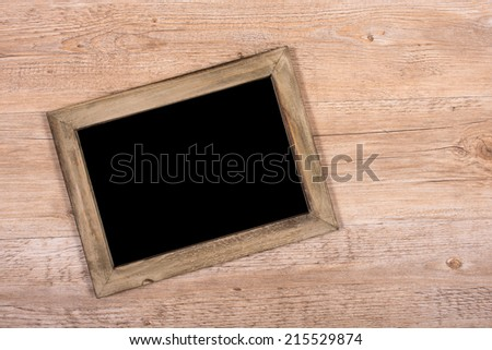 Blackboard with wooden frame and free space for advertising