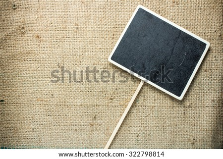Blackboard wooden plaque placed on the right Hollow square style on sackcloth. - stock photo