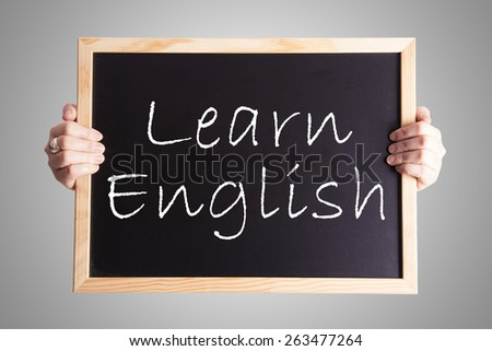blackboard write Learn English - stock photo