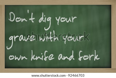 "Blackboard writings "" Don't dig your grave with your own knife and fork """