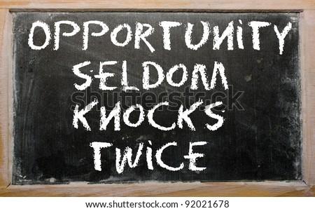 "Blackboard writings ""Opportunity seldom knocks twice"" - stock photo"