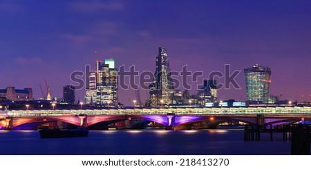Blackfriars Bridge with London urban buildings at night. - stock photo