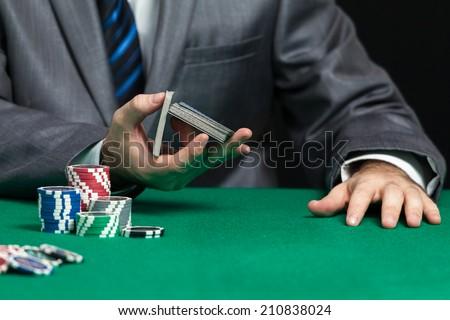 Blackjack In A Casino, Casino Worker Shuffling Cards - stock photo