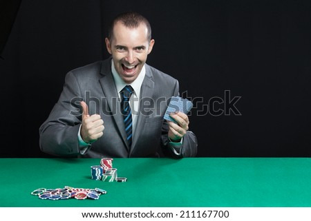 Blackjack In A Casino Happy Man Wins Gets Rich, Screams smile and shows a big like   - stock photo