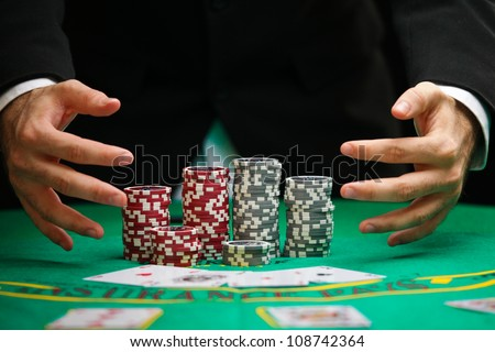 blackjack winner,a solid businessman, won all jackpots in blackjack and takes all the chips - stock photo