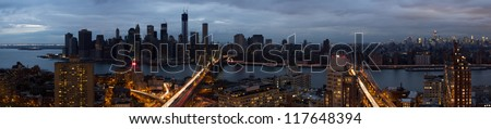 Blackout of lower Manhattan from Hurricane Sandy while still having power from 30th street up - stock photo