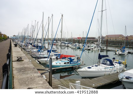 BLACKPOOL, UK - NOVEMBER 3, 2015 - Port of Fleetwood, Fleetwood.  Port in Fleetwood, near Morecambe bay.  Yachts are docked in the marina.