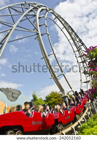 BLACKPOOL, UNITED KINGDOM - JUNE 24: the Revolution rollercoaster at Blackpool Pleasure Beach on June 24, 2014 in Blackpool, United Kingdom. Revolution has a top speed of 45 mph and max G force of 4. - stock photo