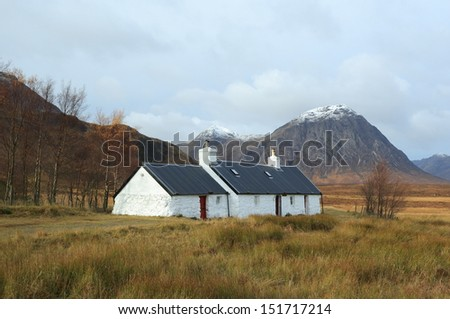 Blackrock Cottage with Buachaille Etive Mor in the background, Glencoe, Scotland - stock photo