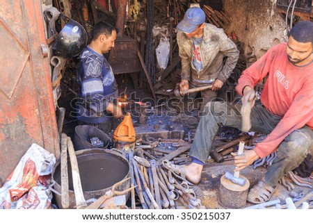 Blacksmith working in a street in front of the smith shop, Marrakech, Morocco. 25-02-2015