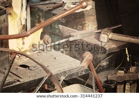 Blacksmith workshop with anvil and fire.Toned image.