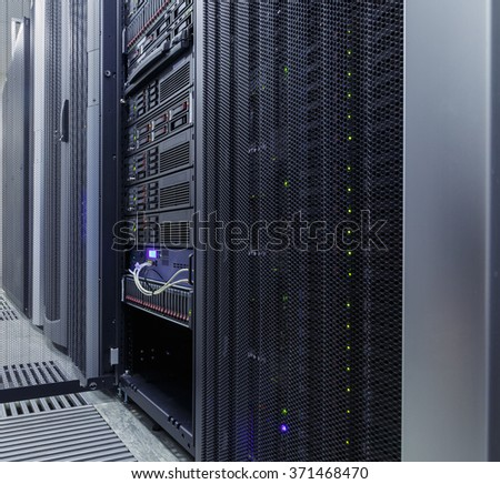 Blade server close-up in series of mainframes data center - stock photo