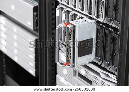 Blade server rack in large datacenter - stock photo