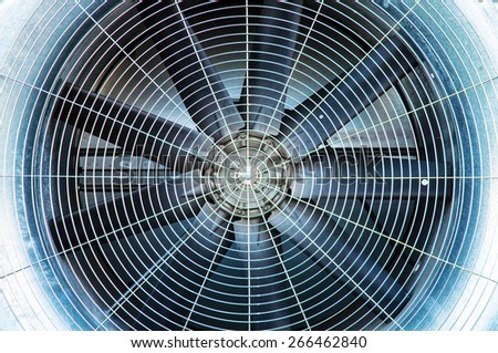 Blades and safety guard of an air condition fan   - stock photo