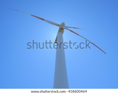 Blades of wind turbine with a blue sky back ground