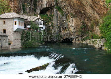 BLAGAJ - BOSNIA AND HERZEGOVINA - MAY 01 , 2015 : Dervish house and source of Buna river in old town Blagaj near the Mostar , Bosnia and Herzegovina