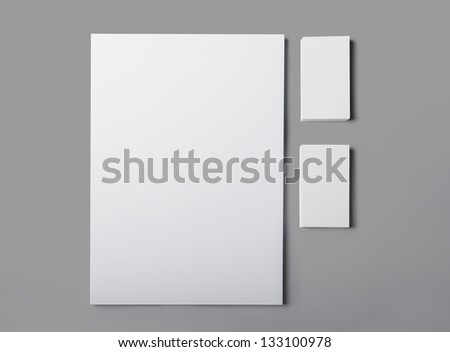 Blank a4 paper stack and business cards isolated with soft shadows - stock photo