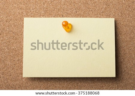 Blank adhesive label pinned on bulletin board - horizontal image
