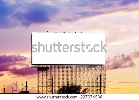 blank advertisement billboard at twilight - stock photo