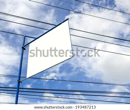 Blank advertisement board on blue sky with messy power cords