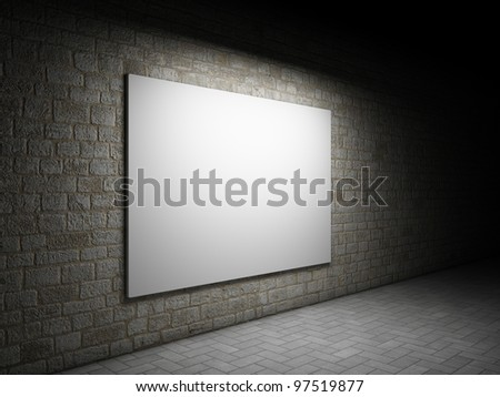 Blank advertising billboard on a brick wall at night