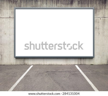 Blank advertising billboard on a concrete wall. - stock photo