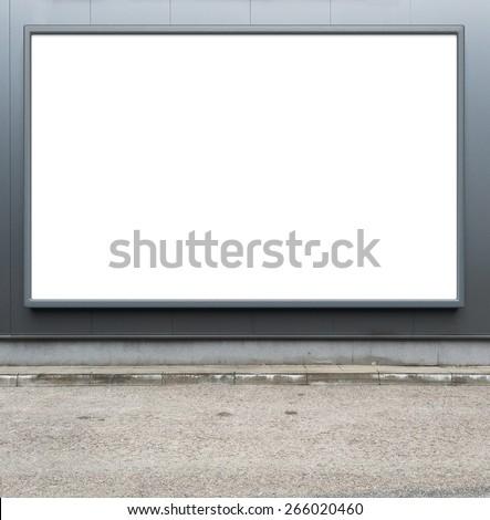 Blank advertising billboard on a street wall. - stock photo