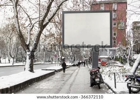 Blank advertising billboard on city street   - stock photo