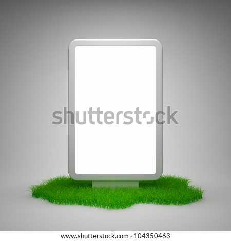 Blank advertising billboard on grass