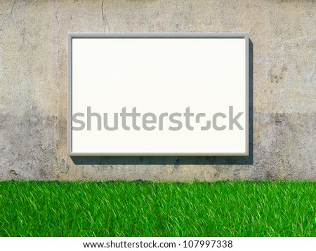 Blank advertising billboard on grunge wall with grass