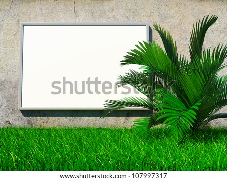 Blank advertising billboard on grunge wall with palm on grass