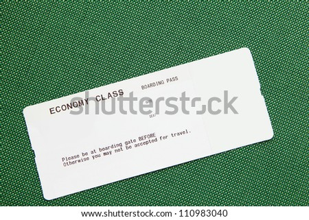blank airline boarding pass on green background - stock photo