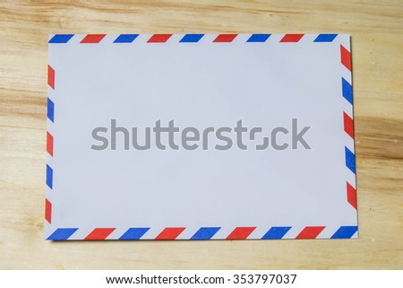 blank airmail envelope on wooden background