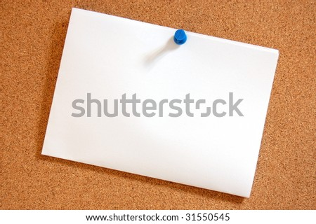 blank and empty sheet paper with copyspace on bulletin board in office - stock photo