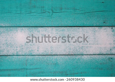 Blank antique teal blue wood beach sign with sand texture - stock photo