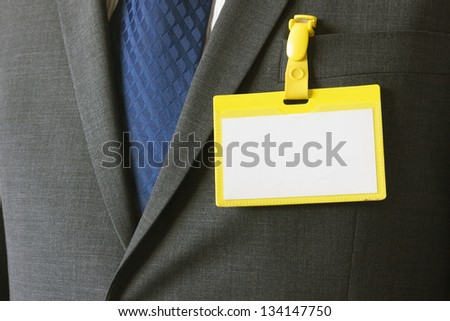 Blank badge with name card on a business suit with empty space for design - stock photo