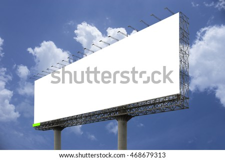 Blank big billboard against blue sky background,for your advertising,put your own text here,isolate white on board,clipping path included