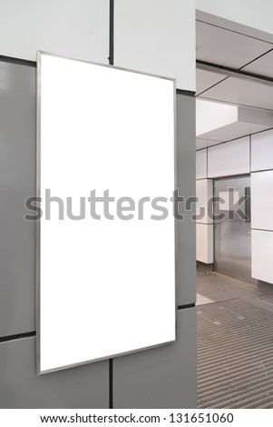 Blank big vertical / portrait orientation billboard on modern gray wall with door background - stock photo